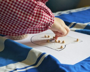 Fine motor skills using tweezers via Lessons Learnt Journal