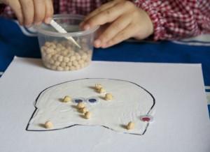 Fine motor skills using tweezers via Lessons Learnt Journal