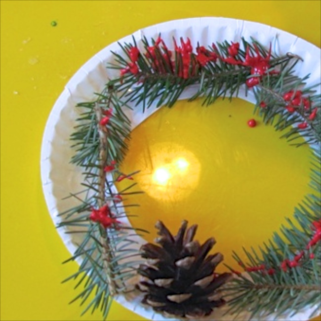 Pine Needle Paper Plate Wreaths via Teach Preschool